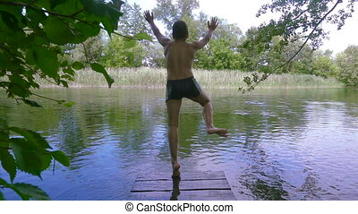 boy jump to the river from pier
