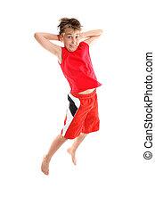Boy jumping hands behind head