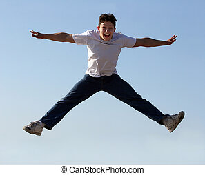 Boy jumping high in the air