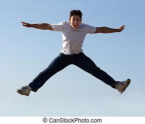 Boy jumping high in the air