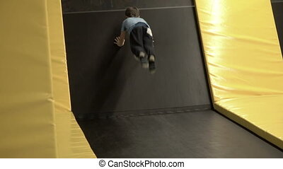 Boy jumping on a trampoline - Little boy jumping on the...