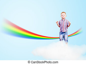 boy jumping on clouds and a rainbow