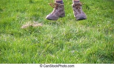 boy jumping on green grass, slow motion