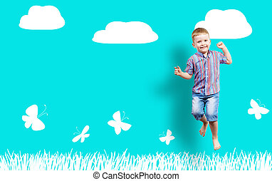 boy jumping on the background of painted wall