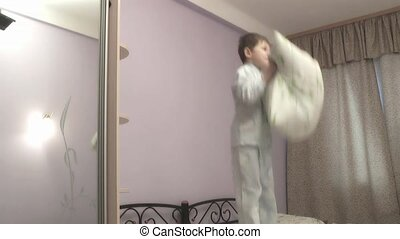 boy jumping on the bed.
