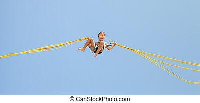 Boy jumping on trampoline - Little boy jumping on a ...