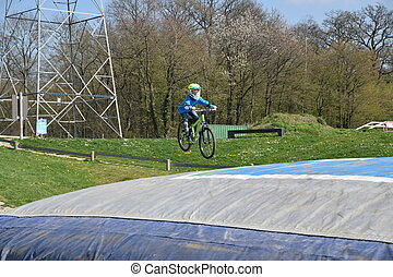 Boy jumping with bike
