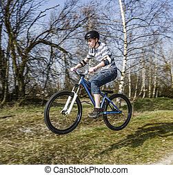 boy jumping with his dirt bike