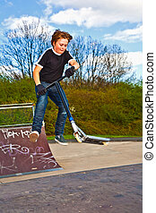 boy jumping with his scooter