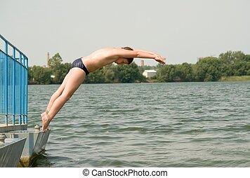 boy jumps in waterrn