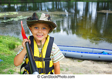 boy kayaking - Portrait of happy young boy holding paddle ...