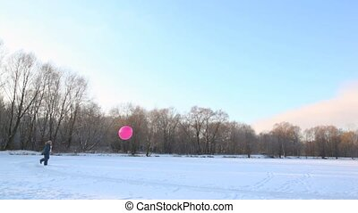 boy kicking air-balloon in snowfield - boy kicking big...