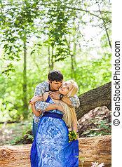 Boy kissing his girlfriend on the cheek