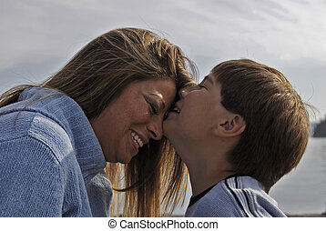 Boy kissing his mother