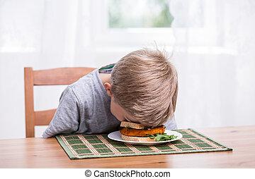 Boy landing face in food - Boy falling asleep and landing...