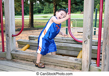 Boy Laughing And Playing At The Park