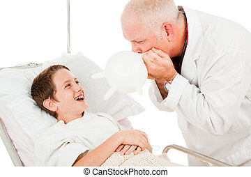 Funny doctor entertains a child by blowing up a surgical glove. Isolated on white.
