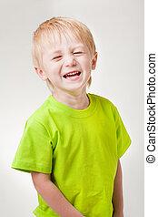 Boy laughs