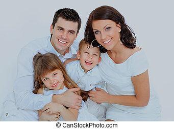 boy laughs with family. - boy laughs with family