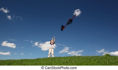 Boy launch black kite on field - boy launch black kite on...