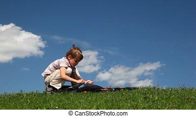 Boy launch kite in meadow - boy launch black kite in meadow...