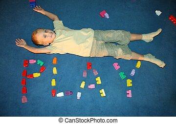 boy laying on floor