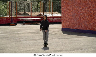 Boy learn to ride a skateboard - Child is practicing...