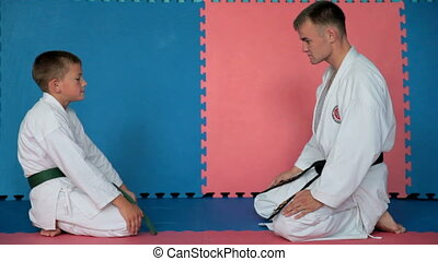 Boy Learning a martial art - Boy learning from his karate...