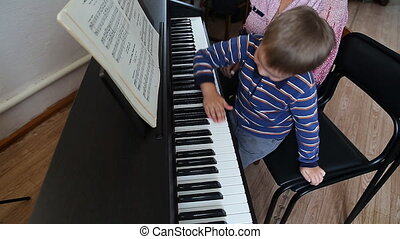 Boy learning how to the play piano