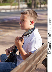 boy learning to play