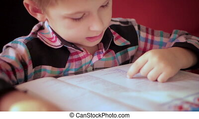 boy learning to read a book1