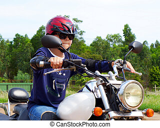 Boy learning to ride an chopper motorcycle 2
