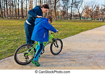 Boy learning to ride bike