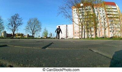 boy learns to ride a skateboard