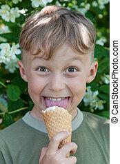 Boy licking ice cream