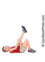 boy lie with leg up on white