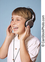 Boy listening music - Child listens to music through...
