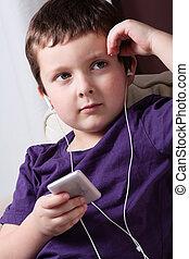 Boy listening to music - Cute little boy listening to music ...