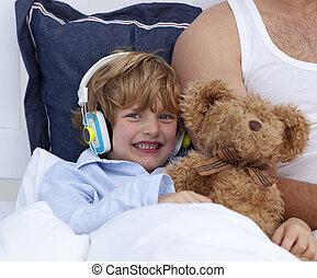 Boy listening to music in bedroom