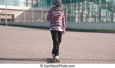 Boy Listening to Music while Skateboarding