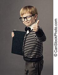 boy little smart child in glasses showing blank card...