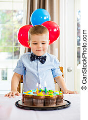 Boy Looking At Birthday Cake