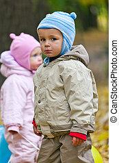 Boy looking at camera with sad face