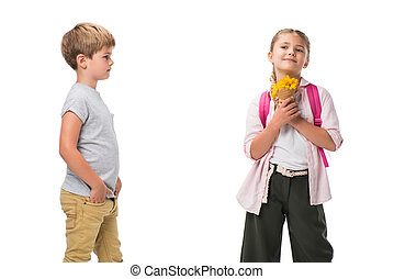 boy looking at happy little girl holding beautiful yellow flowers isolated on white