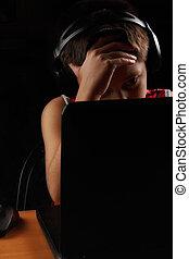 Boy looking at laptop