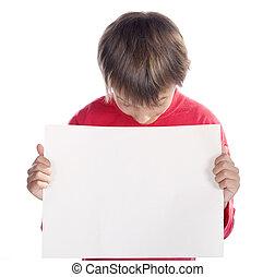 boy looking at placard