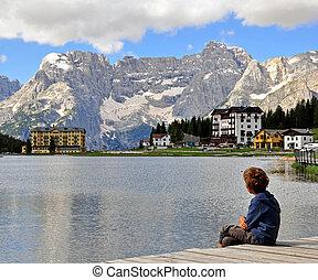 Boy looking at the lake