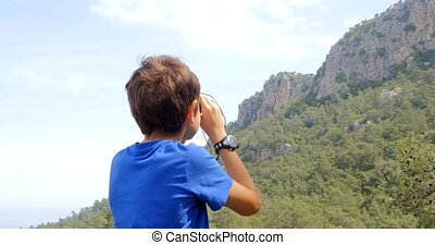 Boy looking at the mountains