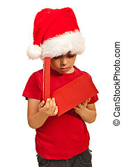 Boy looking in a Christmas box