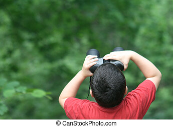 boy looking in binoculars